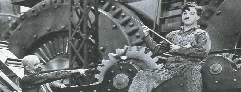 Una scena del film Tempi Moderni di Charlie Chaplin